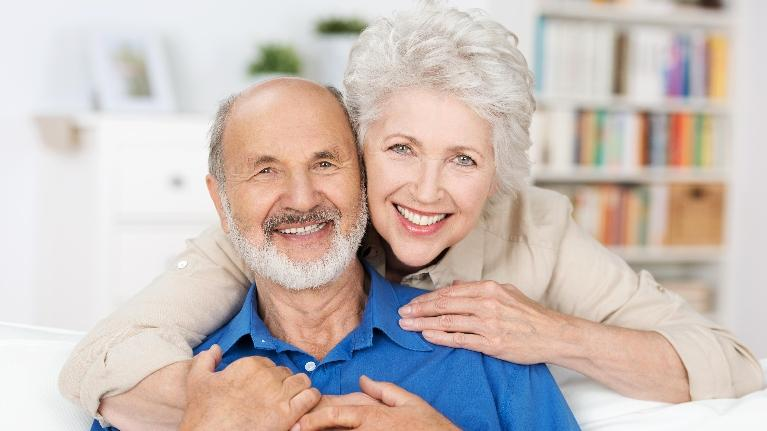 An Elderly Couple Smiles | Bayport Dentist
